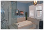 Transform your outdated Bathroom to a spa like enviroment by opening up the shower area and making i